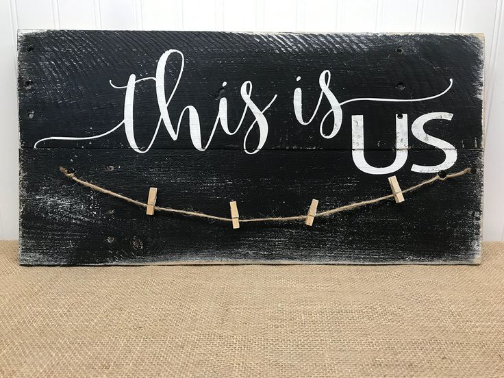 This Is Us Decorative Reclaimed Wood Pallet Photo Holder Sign Home Decor 22x11. Families are messy, but for better or worse, This Is Us. The relationships we have with the people we love most are the most important in our lives. This photo holder can hold multiple pictures and display them on this rustic pallet wall art. 22x11 Due to the handmade nature of each sign, there may be slight variations. © May 2017 - original design by Julie Schnatterly of Mrs. Sasquatch's Barefoot Studio.