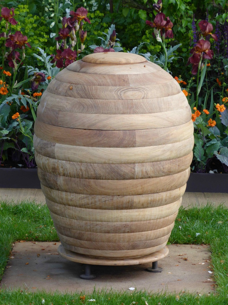 Wooden beehive at RHS Chelsea Flower Show 2013 - Homebase Garden designed by Adam Frost