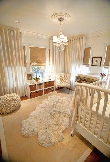 Neutral nursery with blinds and floor length curtains
