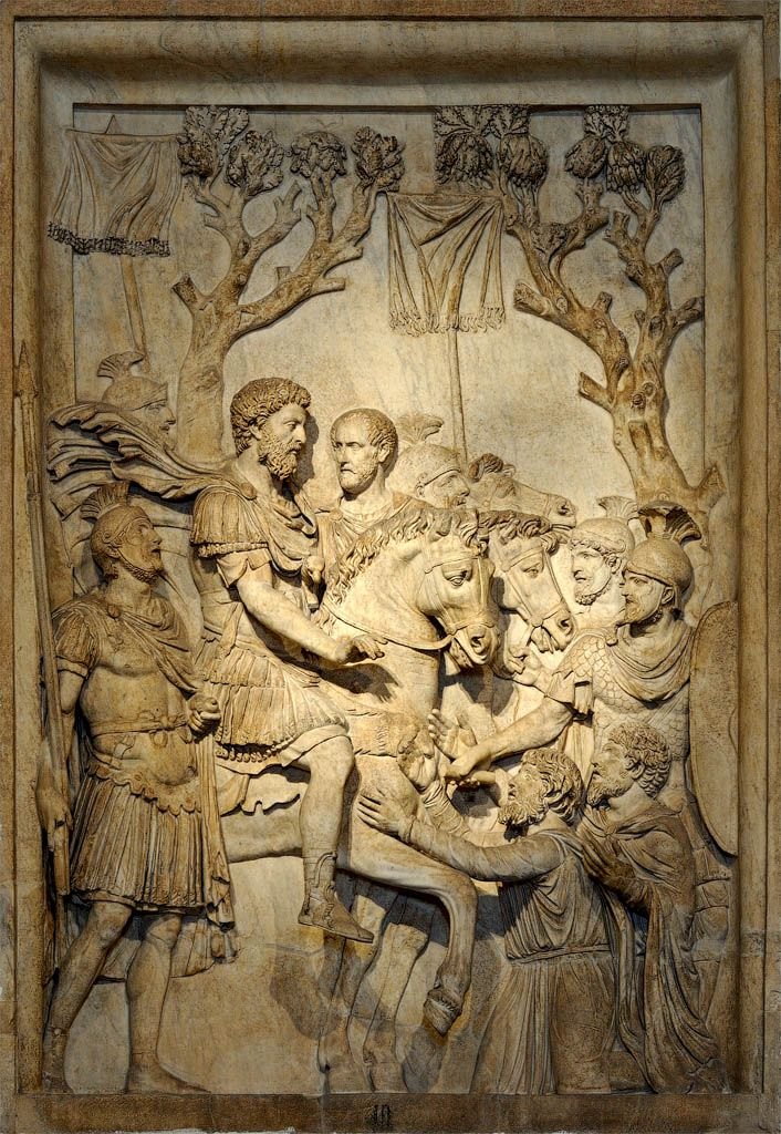 """Emperor Marcus Aurelius, soldiers and the defeated (""""The clemency of the Emperor""""), Roman relief (marble), presumably from the Triumphal Arch of the Emperor, 2nd century AD, (Palazzo dei Conservatori, Rome)."""