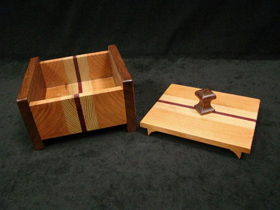 This handsome box is made from book-matched pieces of black walnut which make up the sides. cherry and sassafras, joined to a center strip of purple heart. The handle is made from a select piece of black walnut. Perfect for that hard to shop for person, a one of a kind heirloom box! To hold jewelry, or special keepsakes, on the desk. dresser, or nightstand, this box will add a touch of class to any setting. Give a gift that will last a lifetime! I have also sold this type of box to hold the…