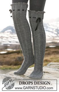 """Long DROPS socks in """"Fabel"""" with cables, lace pattern and silk ribbon. ~ DROPS Design  LOVE!!"""