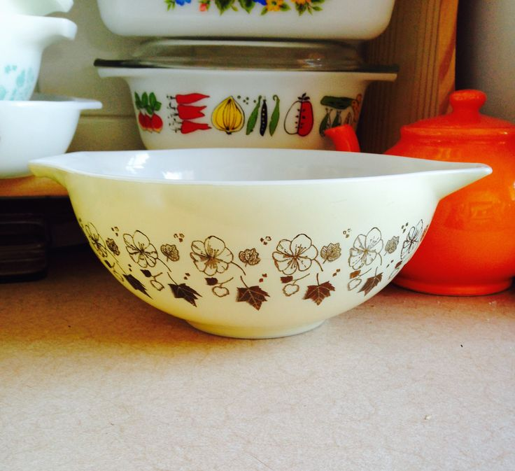 Fairly rare JAJ Pyrex Golden Ivy pattern Cinderella (mix n pour) Bowl, would have originally been offered with atomic candle stand and knobbed handled lid, with 1960s JAJ Harvest pattern small oval casserole in background