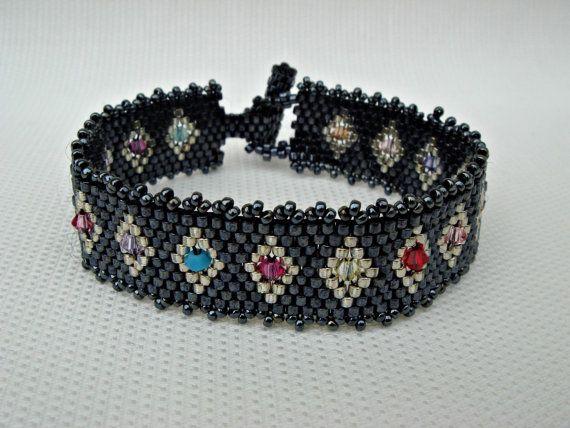 Black beaded beads bracelet with multicolored Swarovski elements. Handmade beadwork beads.