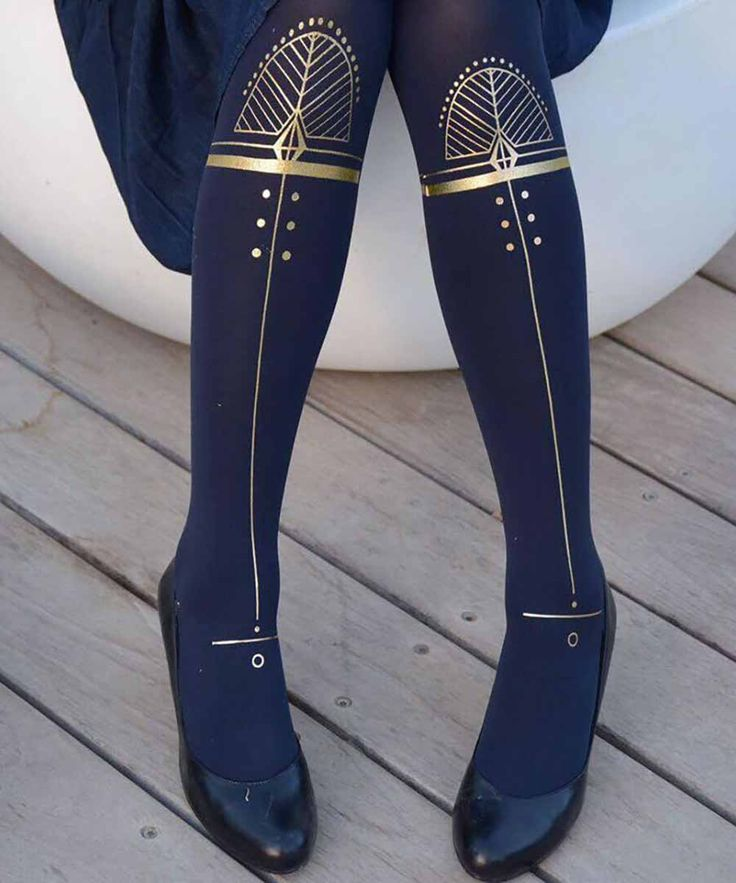 Make a fashion statement with these printed tights by Zohara. These one-size navy blue tights feature a Hypnotic print