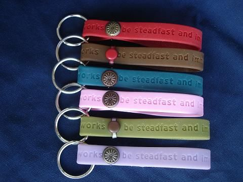 Turn your theme braclett into a keychain.-i like this a lot better than wearing them.