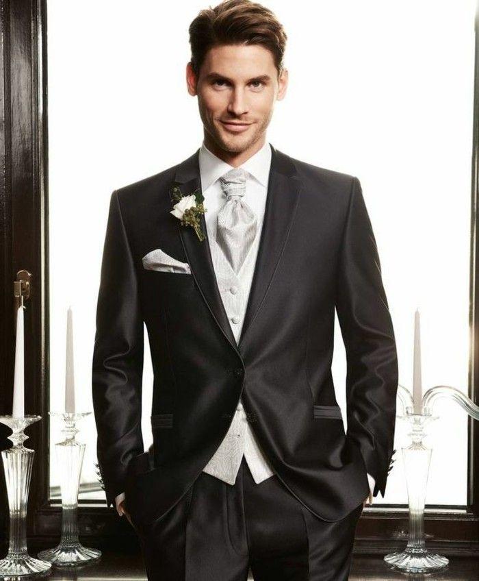 una proposta elegante per un abito matrimonio uomo grigio scuro con  panciotti e cravatta grigio perla 7617e4a0dab