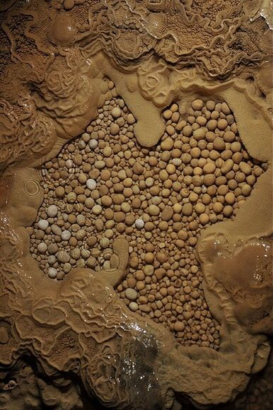 Cave pearls  - The original photo can be found at https://www.flickr.com/photos/caving/3483209570/