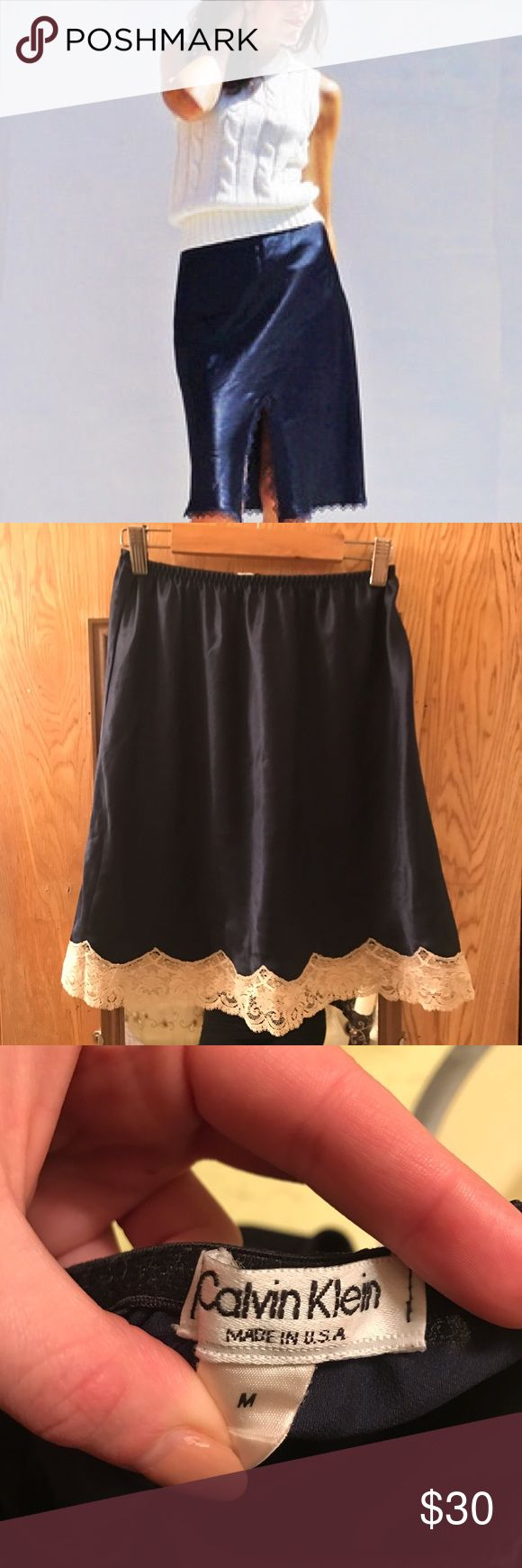 Calvin Klein navy silk and lace slip skirt Gorgeous Calvin Klein navy silk and lace slip skirt made in USA can fit size small-medium. Such a luxurious texture and color! Can be worn high waisted as mini or longer knee length if placed on hips. Trim is a cream delicate lace Calvin Klein Skirts Midi