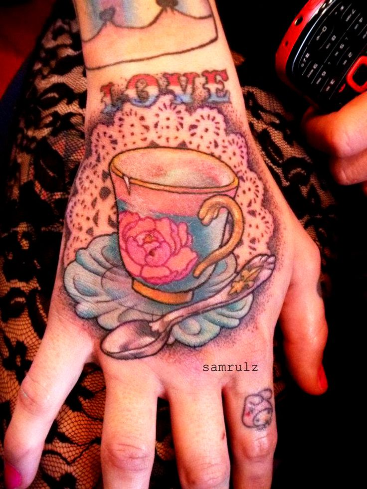 teacup tattoo. maybe not on the hand but that's really ...