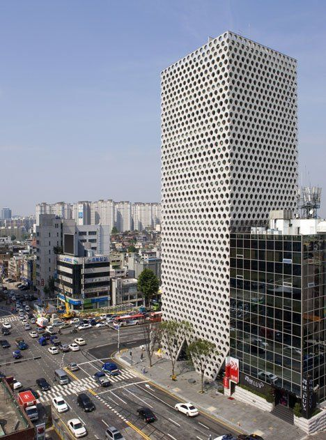 The dotted facade of the Urban Hive building in Seoul's Gangnam district was developed by Archium as a load-bearing surface that enables the interior spaces to be largely free from supporting structures.