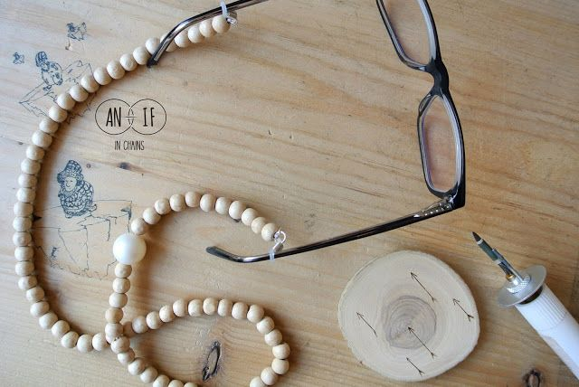 Wooden eyeglasses chain with pearl. Special accessory.
