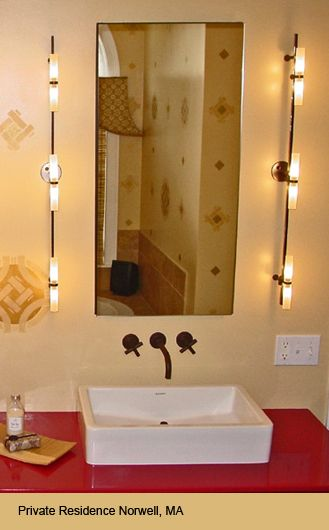 bamboo style lighting in a double sink and multiple mirror style