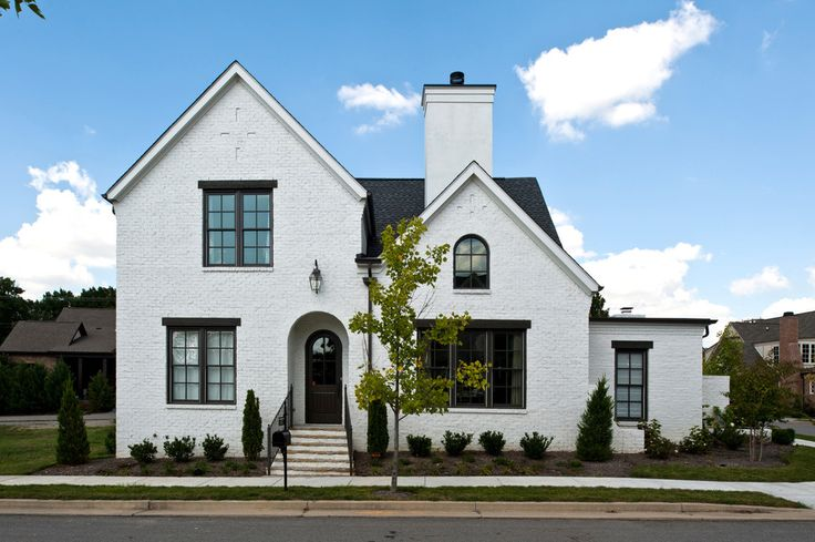 White house exteriors exterior traditional with stone stairs black window trim exterior houses - Black house with white trim ...