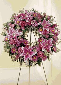 "We Fondly Remember Wreath by FTD. $175.00. Approx. 24"" dia. The FTD® We Fondly Remember™ Wreath. Stargazer lilies are used to remind how special she was in this soft pink wreath. Appropriate to send to the funeral home. Arrangement is delivered with an easel for display."