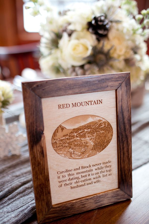 Wooden mountain table signs by Naturally Chic | Photo by Julie Williams Photography. #woodtablenumber #skiwedding #winterwedding #emeraldlakewedding