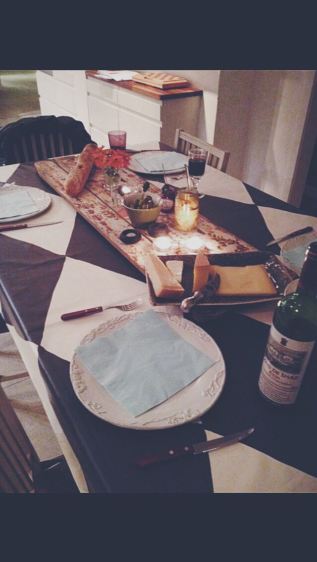 Family dinner . Table setting. Wine and cheese