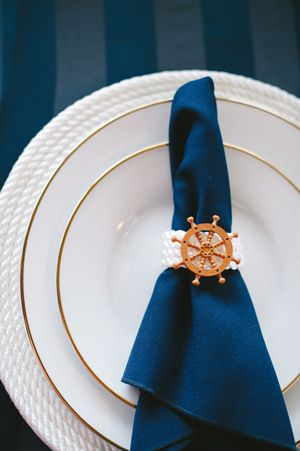 Nautical Boat Wedding Ideas... the gold rimmed plates dress up the nautical theme beautifully!