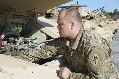 Army Staff Sgt. Jeffrey Hoffhaus, with the South Carolina National Guard's Alpha Company, 4th Combined Arms Battalion, 118th Infantry Regiment, inspects his Bradley fighting vehicle before a gunnery exercise at Fort Stewart, Ga., April 10, 2017. South Carolina Army National Guard photo by Capt. Brian Hare