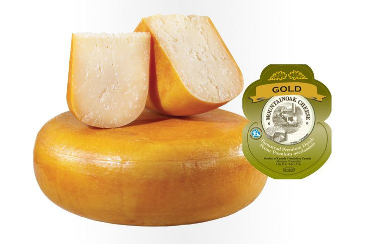 """Mountain Oak """"Gold Gouda"""" Cheese: This multiple award winner made by the Mountain Oak Cheese company of Wilmot Township, continues the tradition of great-tasting, high-quality, full flavoured farmstead gouda that exudes hints of butterscotch and caramel. made with high-quality, fresh milk from their own dairy cows. Ingredients: Whole milk, bacterial culture, salt, calcium chloride, rennet."""