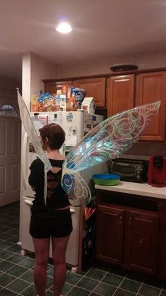 damianrules:  I said I'd write up a tutorial on how to make these wings. It'll be terrible So, here goes. XD Have one or two friends to help you out. It's easier with more hands.Materials: Thin poster board. (For small wings you will need 3 pieces. For wings like this you will need 6) Opal cellophane. (two rolls to be safe) Adhesive glue. Scissors. Wire cutters. Exacto knife. (I recommended using this for cutting out the poster board) Hot glue gun. 3 Hanger wires (it's super sturdy) Pencil…