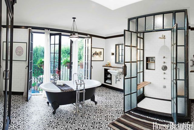 Drummonds' Spey tub and standpipe take center stage, but the glass-and-steel shower stall, fabricated by Elite Remodeling, is equally eye-catching. Wall tile, Michael S. Smith for Ann Sacks. Floor tile, Cluny by Granada Tile. Tub shelf, Etsy. Rug, Woven Accents. Vintage pendant, Obsolete. Ceiling paint, Dunn-Edwards Suprema in Bone China.   - HouseBeautiful.com