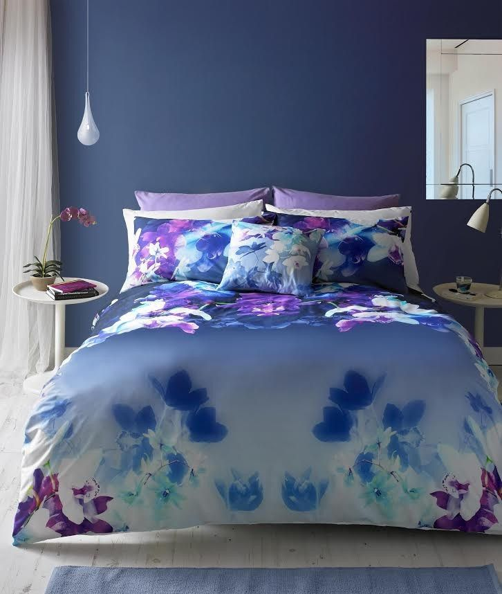 In A Bold Floral Design This Lipsy Mirrored Orchid Duvet Covet Set Features Dreamy Blue And Purple Orchids A Duvet Cover Sets Duvet Sets Purple Duvet Cover