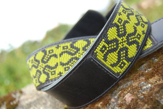 Inspired by native american bead work.  Handmade unique bead woven leather belt with ancient Latvian (Baltic) ornament.   The Sing of the moon is symbol of Latvian mythology. The Moon sign is the symbol of circle of life and represents the rise and wane of all the things.  Made in loom bead technique with black and green Czech glass seed beads (size 11).  Sewed on genuine black leather.  Metal buckle closure.  Width 4,5 cm ( 1,7 inches).   Please write me a message, or leave a note during…