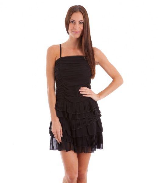 Utfordrende sort kjole