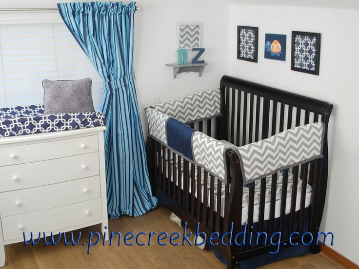 Blue And Navy Stripe Drapes With Grey Chevron Crib Bedding For A Geometric Baby Nursery