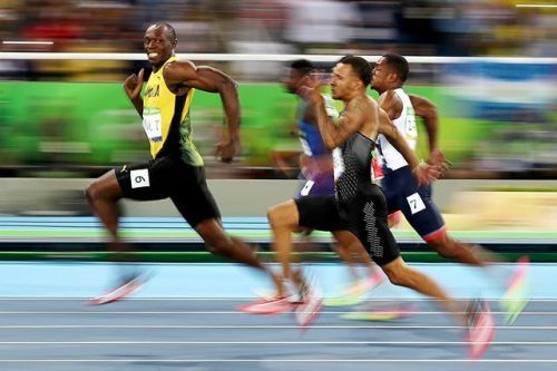 The 100 metre sprint is the blue ribbon event of the Olympics. My role on this night was to shoot the semi-final and final from the inside of the track cover the finish line and then do the lap of honour with the winner. I chose to pan Bolt from the 70m mark using a slow shutter speed at 1/40th of a second on a 70-200mm f2.8L lens and a Canon 1D X Mark II. Confident he would be leading his semi-final race by this mark. It wasnt until I looked at the back of my camera that I noticed he was…