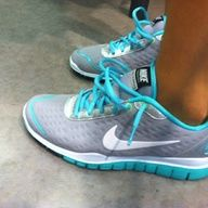 Light gray nike with turquoise trim and white swoosh
