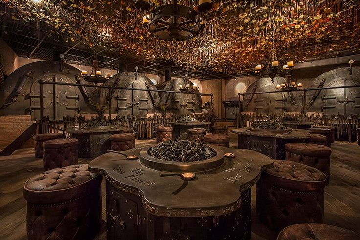 vials of 'fairy dust' and metal-making tools decorate the eclectic iron fairies bar interior that appears to have come straight from a fairytale book.