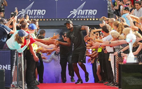 Usain Bolt Photos Photos - Usain Bolt of Usain Bolt's All-Star celebrates with supporters in the crowd as his team run onto the track during the Melbourne Nitro Athletics Series at Lakeside Stadium on February 11, 2017 in Melbourne, Australia. - Nitro Athletics Melbourne
