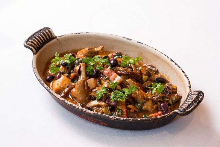 A twist on a classic cacciatore, this hunter-style stew recipe from Francesco Mazzei uses rabbit for a hearty game dish. Cooked with pancetta, wild mushrooms and served with olives and capers.