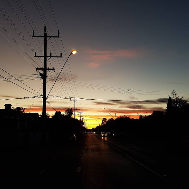 Dawn over Brunswick. Melbourne really turning on the skyporn lately! 😍  #nofilter #dawn #sunrise #brunswick #skyporn #ishouldntbestandingthere #middleoftheroad #urbanlandscape #urbanjungle #streetlight #silhouette
