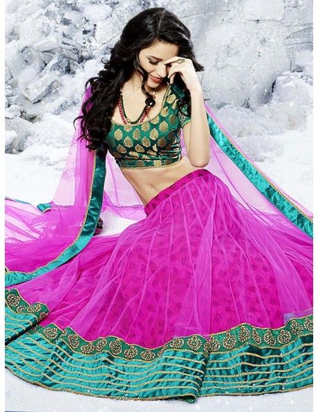 Classy look in this rani pink color self design inner part net lehenga is garlanded with gleaming zari, kundan work design, amazing contrast patch on bottom part, green color brocade choli and matching net dupatta with contrast patch on border are giving bloom to it. Update your wardrobe with this decent and exclusive design. http://www.bharatplaza.in/new-arrivals/lehengas/classy-look-net-lehenga-gji1439p.html