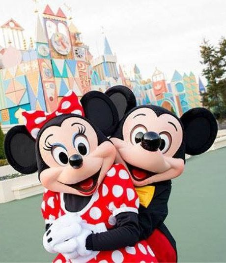 Awwww! Mickey and Minnie in front of Small World