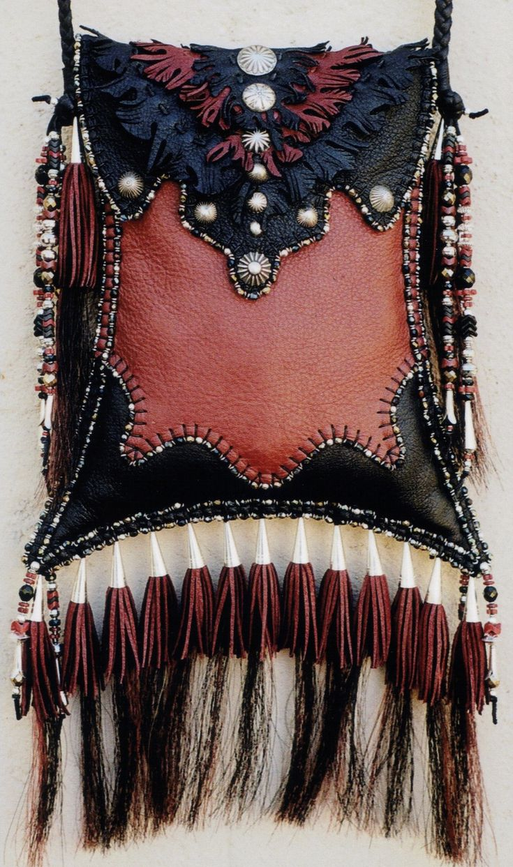 Swallow Tail with Navajo Buttons. Made by Carole Hook.