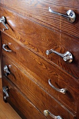 #DIY car door handles and window cranks on a dresser.
