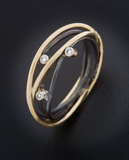 "Ring |  Randi Chervitz.  ""Wrapped"".  Oxidized sterling silver, 18k gold, white d..."