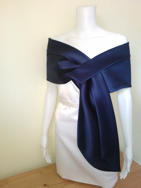 This is a wrap which is shaped and slit for easy styling. It has an eyehole underneath the upper fold.  Brand: My Cover Up  New / unworn / with tags  62 long fits clothing size 8-14UK 65 long fits clothing size 16-24UK  Colour: Navy blue    Made of excellent quality duchess satin fabric (low luster)    It is a bias cut shawl  What is a bias cut garment?  The bias-cut is a technique used by designers for cutting clothing to utilize the greater stretch in the bias or diagonal direction of the…