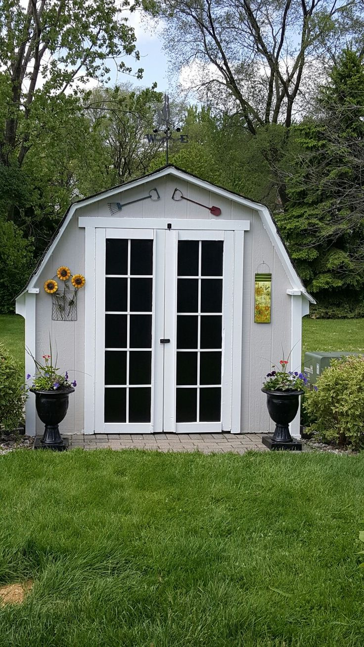 Completed french door shed makeover. Very simple. Just painted doors black with rustoleum black gloss paint and then went to Home Depot and used vinyl strips and measured out my door starting with center and placed the vinyl strip,  and then measured length so we had even panes and then just nailed vinyl strips horizontally as well. Done in one day tops. Love the finished look, and getting lots of compliments from neighbors, friends and family. Decor (except urns we had those),  was all on…