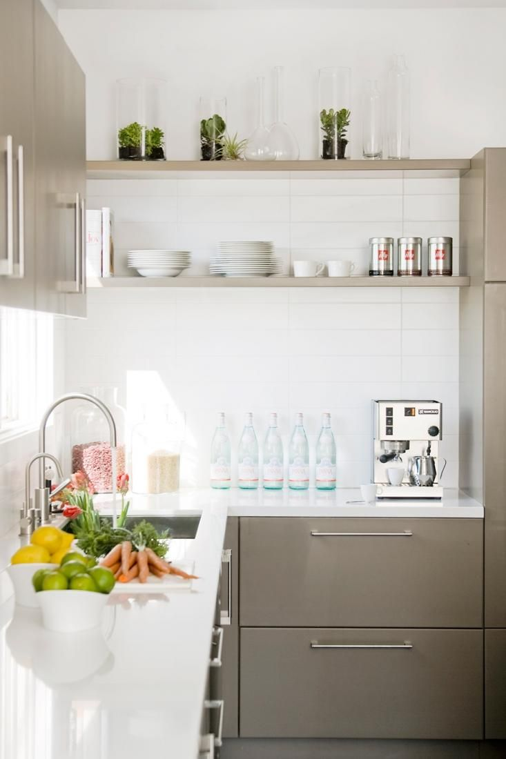 plants in glass (on top of the photo) Gray cabinets in white kitchen by Nicole Hollis, Remodelista