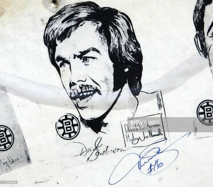 Derek Sanderson is a guest analyst for WBZ-TV on June 18, 2011, for the Bruins victory parade. Before the start of the parade, Paul P. Benoit, of Ware, MA, holds up a poster of the 1971-1972 winning team that he found in his home's attic. He said it was left by a previous occupant.