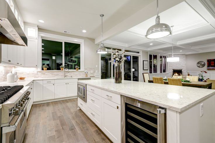 The most beautiful kitchen countertops combine elegance, versatility and durability and these kashmir white granite ones do that and more.
