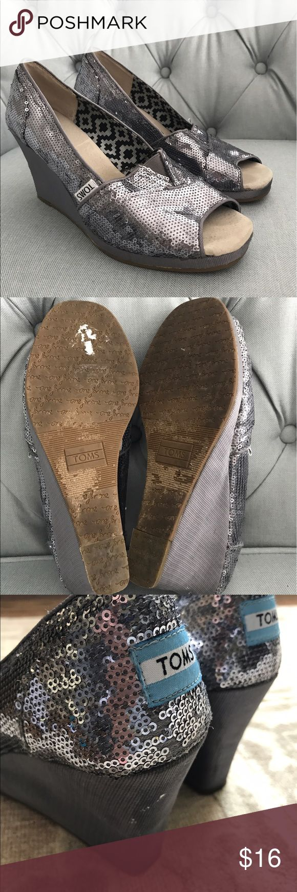 Toms silver gray sequin stacked wedge shoe TOMS silver sequin sparkly peep toe wedges. Please note there are visible markings on back of both heels (see pics). Markings from wear/use. However interior soles clean , bottom soles in good condition. Very sparkly!! 3 1/4 inch heel. Toms Shoes Wedges
