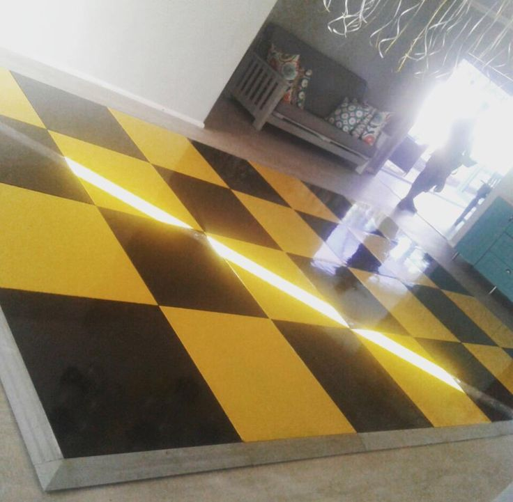A bright black and yellow painted dance floor ready to roll #connectafloorcape #eventflooringcapetown