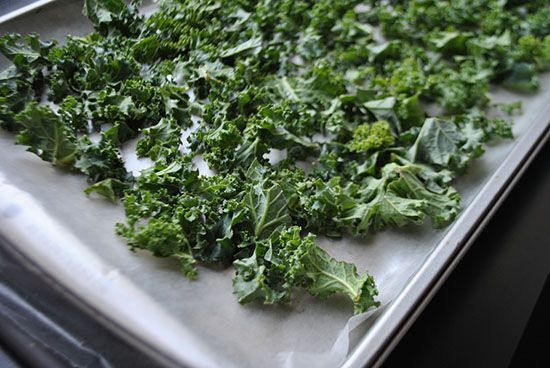 I've discovered a foolproof way to make kale chips. How many times have you burned the kale chips because you weren't watching them carefully enough? I'm sure I'm not the only one!   Heat your oven up to 425F, get the kale ready (washed, shreddded, spun, coated with fat  salted or seasoned) then the minute you put the kale into the oven turn the oven OFF.   Let the kale sit in the oven for 15-20 minutes. Result: perfect evenly cooked crisp kale chips. Nothing burned.