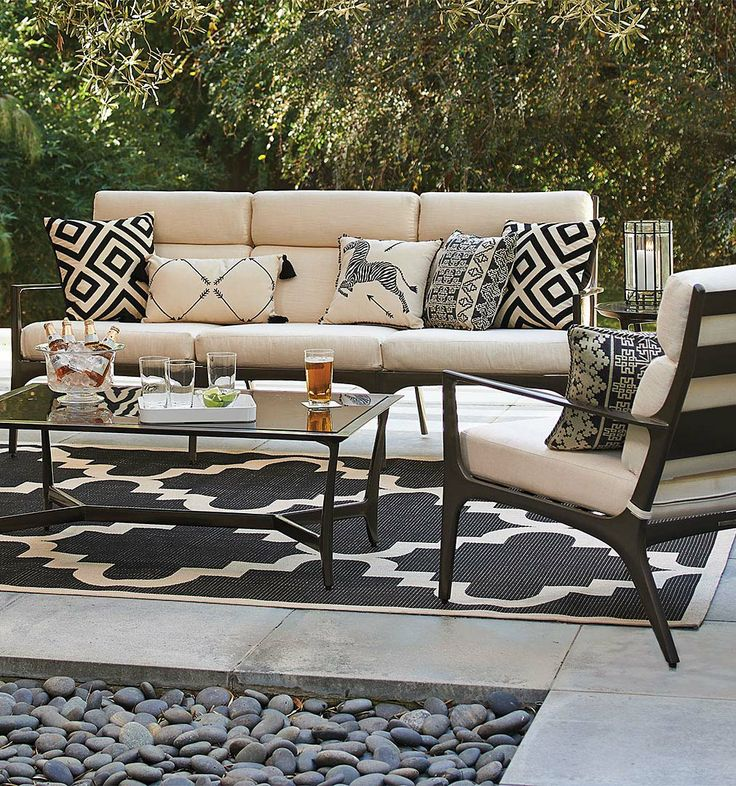 The Anders Seating Collection translates the pure elements of midcentury Danish design into solid cast aluminum, made extra-durable with an architectural-grade bronze powdercoat finish. | Frontgate: Live Beautifully Outdoors